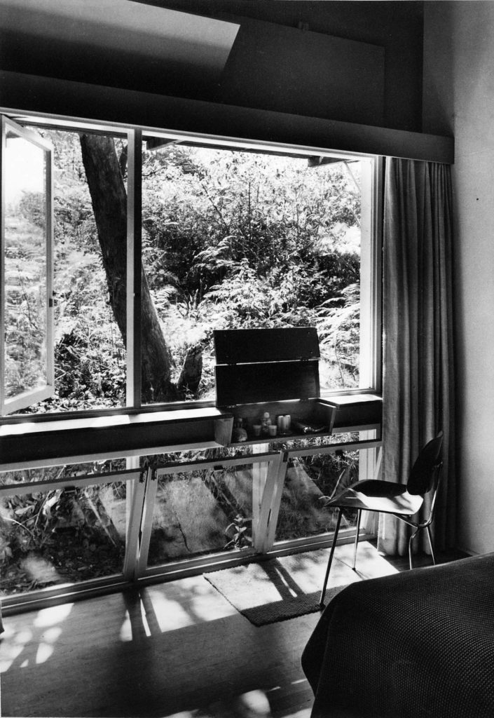 Main bedroom facing north to a steep embankment of natural bush. The dressing table was a built-in shelf as part of the window with a lift up lid with mirrors. Note the ventilation flaps above the window which enabled summertime air movement when the curtains were closed. No double glazing in those days – either not available or too expensive or, more usually not considered essential in the mild climate of Sydney. Frosts were virtually unknown.
